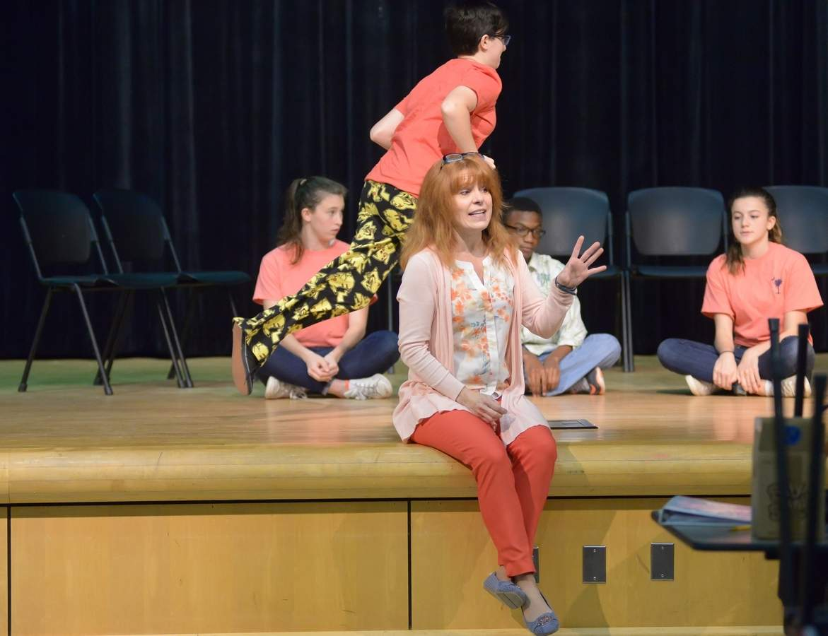 Daniel Hand High School's Hands-On-Stage Company Theater Arts Program rehearses for their upcoming performance of Cheaper By the Dozen.  Director Joy Grabow talks to cast while some of the actors take their places for the next scene.