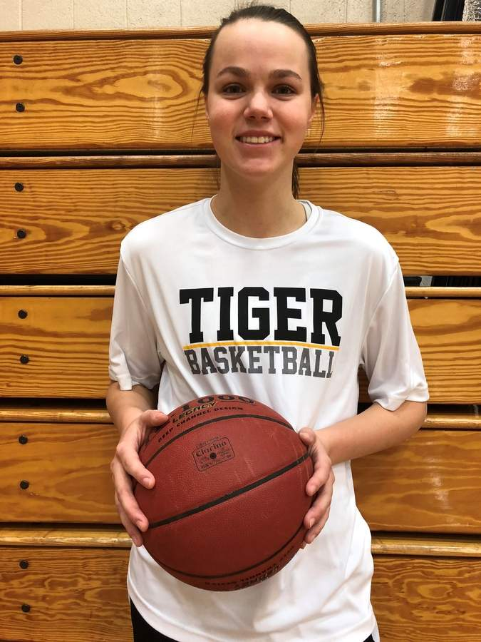After leading the Hand girls' basketball team in rebounds and blocks last year, Halle Freund has continued her steady improvement as the Tigers' center by averaging robust totals across the board this season. Photo courtesy of Halle Freund
