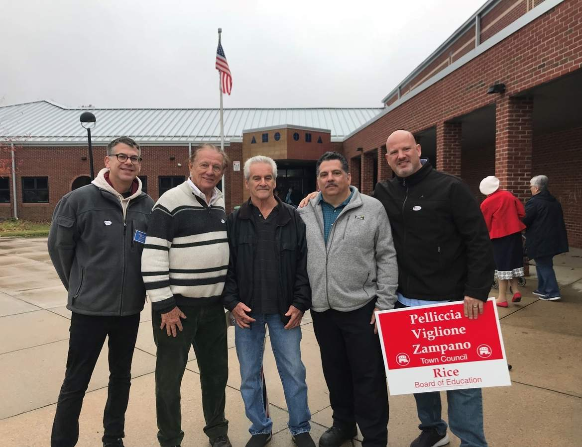 Showing bipartisan spirit at Jerome Harrison School's District 1 polling place in North Branford on Election Day are Town Council candidates (l-r): Dan Armin (D), Joe Martin (D), Bob Viglione (R), Tom Zampano (R) and Ron Pelliccia (R). Pam Johnson/The Sound
