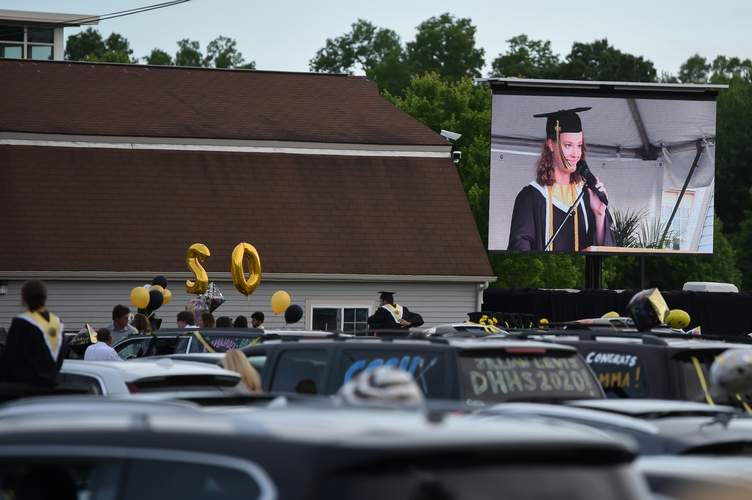 At Daniel Hand High School's drive-in-style graduation on June 18, speeches such as the salutatory address by Kylie Corniello were projected onto a screen above the stage. Photo by Kelley Fryer/The Source